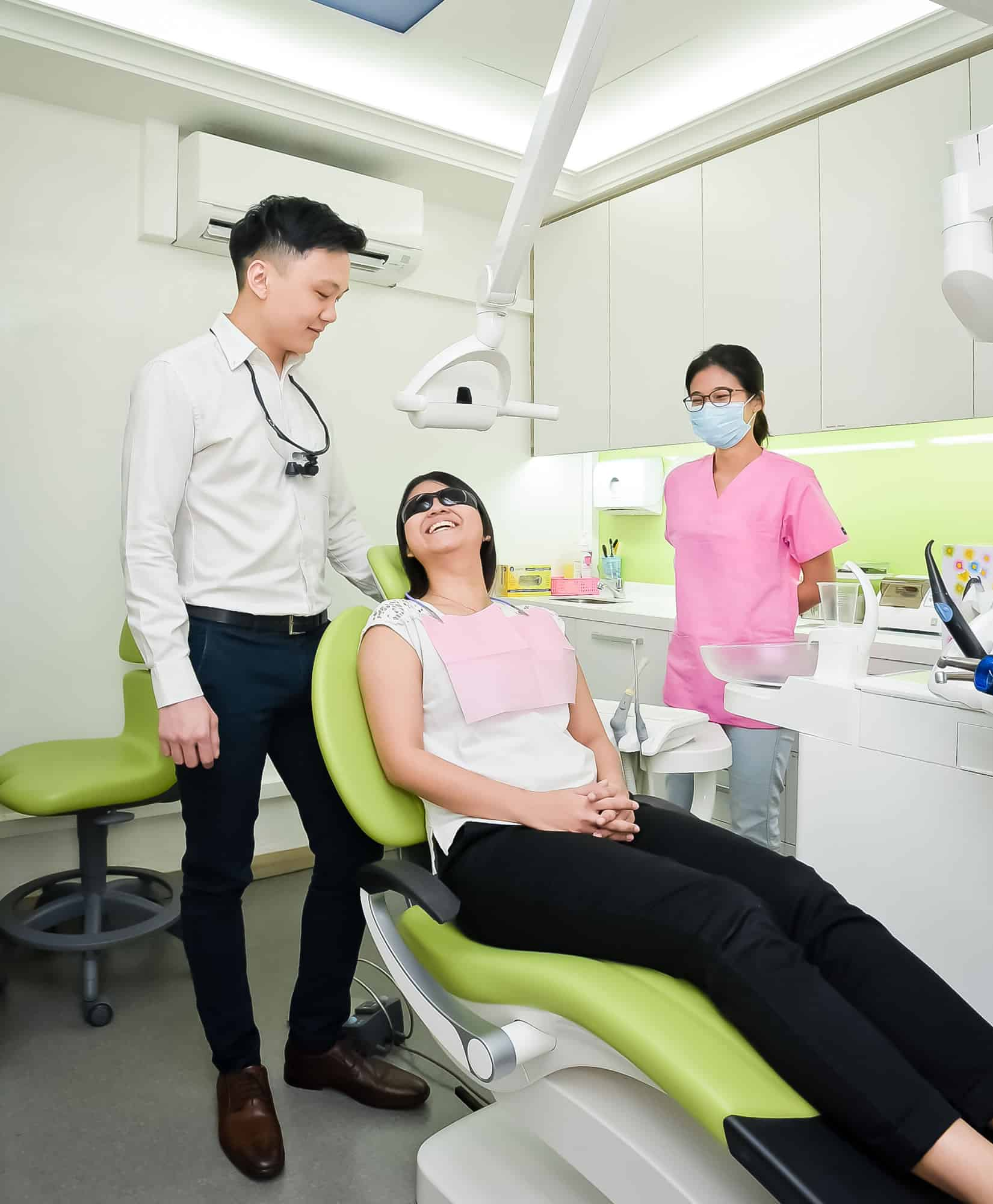 Patient check-up with Dr Russell and dental nurse