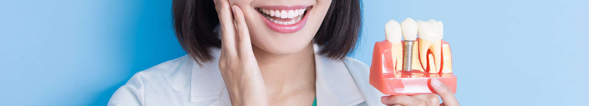 woman dentist taking implant tooth