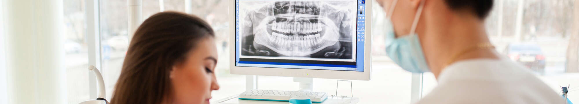 dentists analysing xray