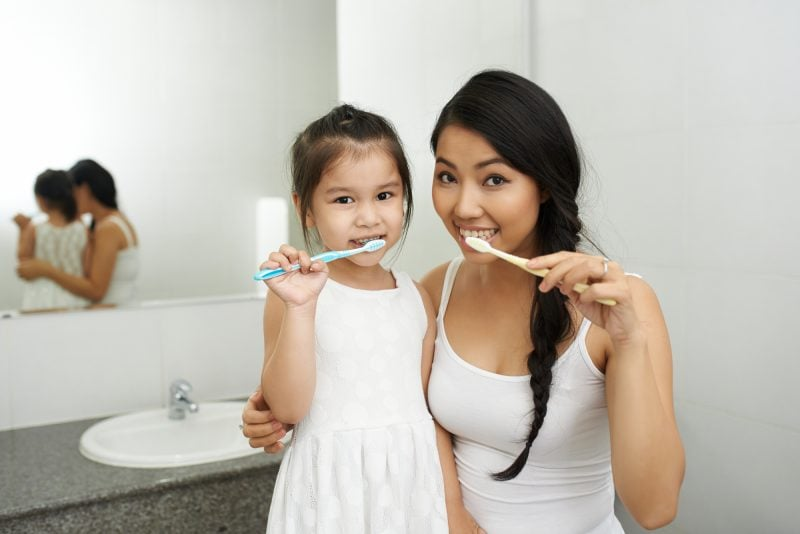how to make your teeth naturally by practising proper oral hygiene