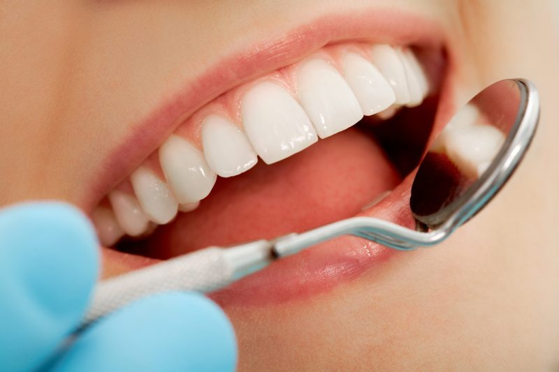 regular dental check up is a way to adopt good oral hygiene habits