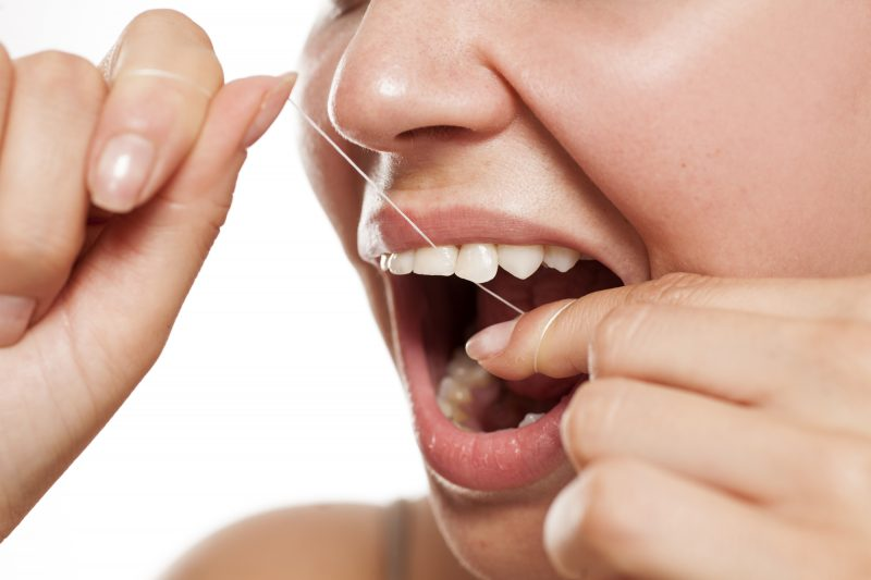 flossing is a way to adopt good oral hygiene habits