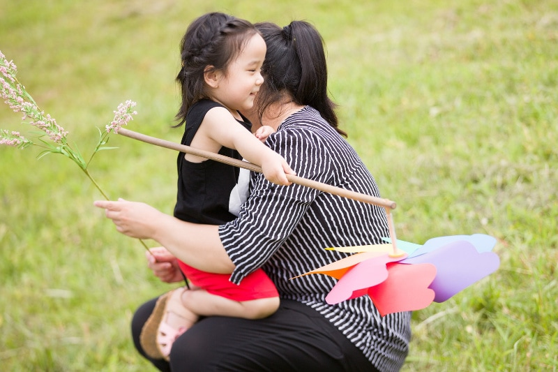 Kids Dentist Singapore - child hugging her mother
